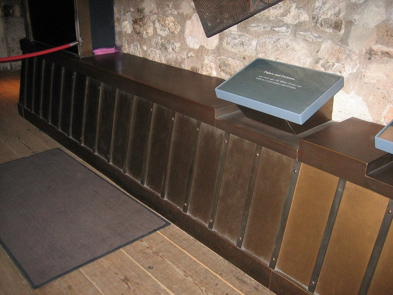 Thermal metal finishes. Bronze finished display stands in the Tower of London, White Tower.