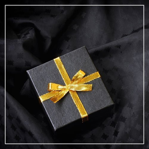 Black Gift Box with Golden Ribbon Bow