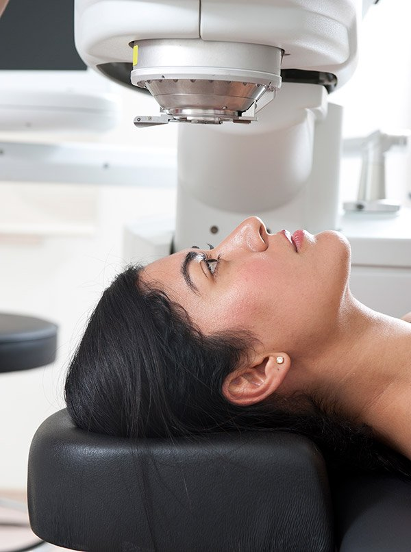 Women undergoing laser treatment