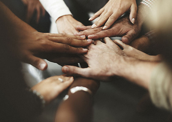People With Joined Hands as a Team