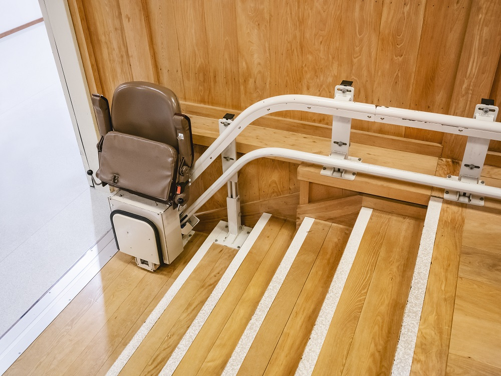 Stairlift on wooden staircase