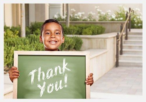 Boy Holding Thank You Chalk Board