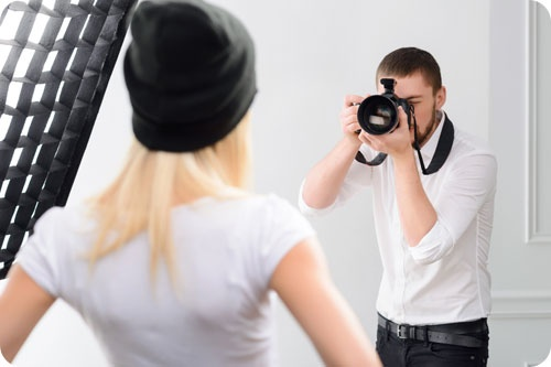 Young Male Cameraman During Genuine Work