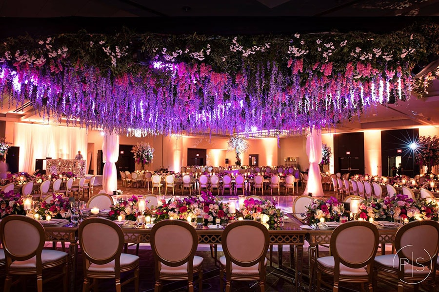 an Unforgettable Floral ceiling for dancefloor, and table centerpieces