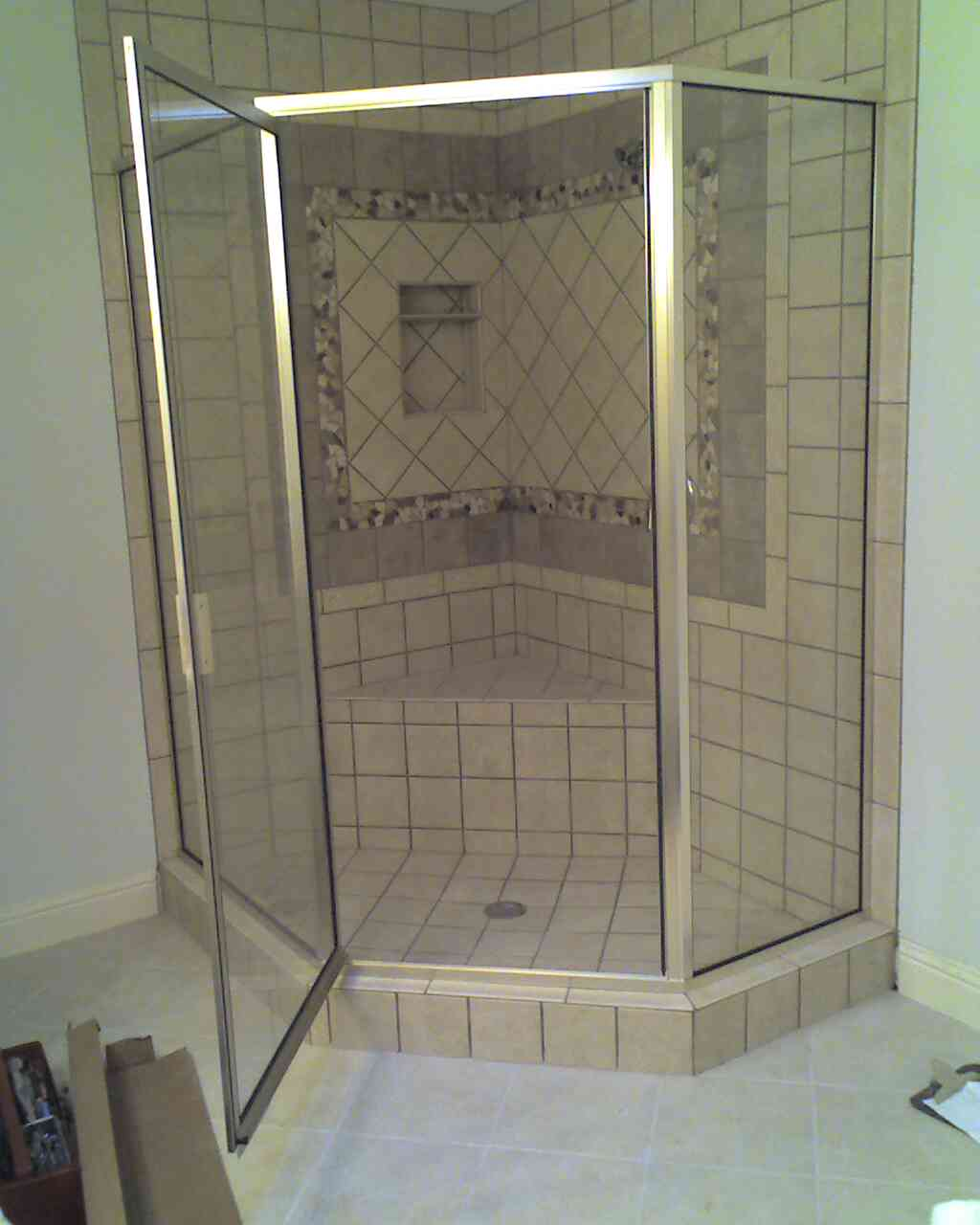 Corner glass shower with brass trim||||