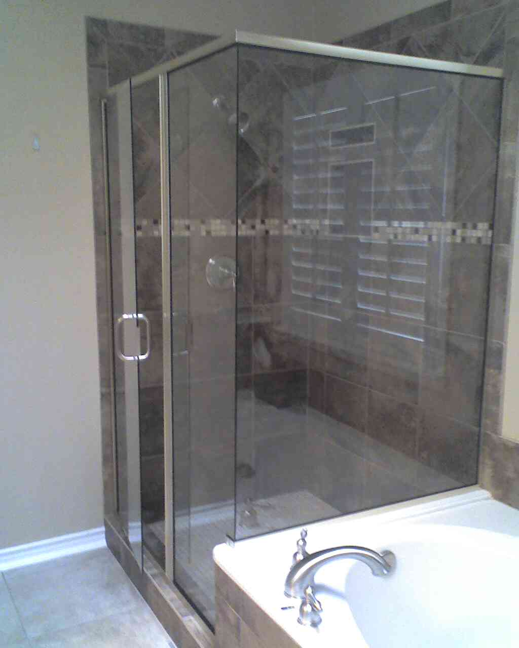 Corner glass shower with nickel trim||||