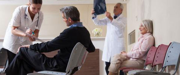Doctors reviewing x-ray at hospital reception