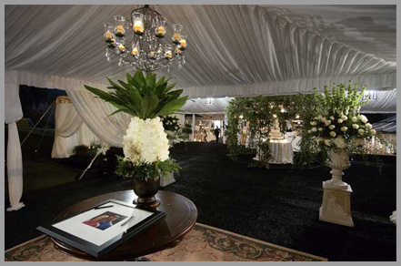 Tent with beautiful flower arrangements||||
