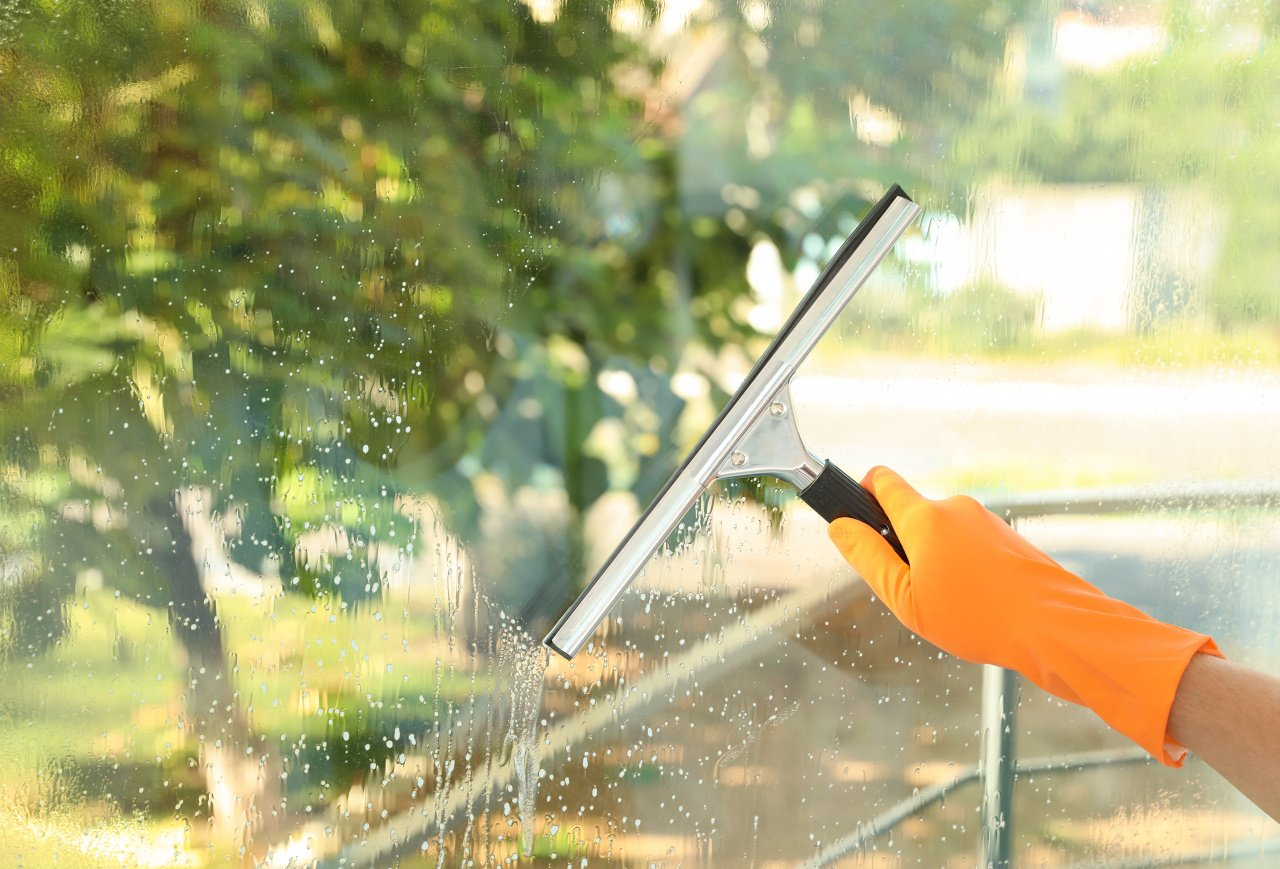 Post-construction cleaning service in Dallas, TX, washing windows