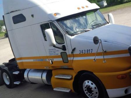 Yellow and white truck repaired
