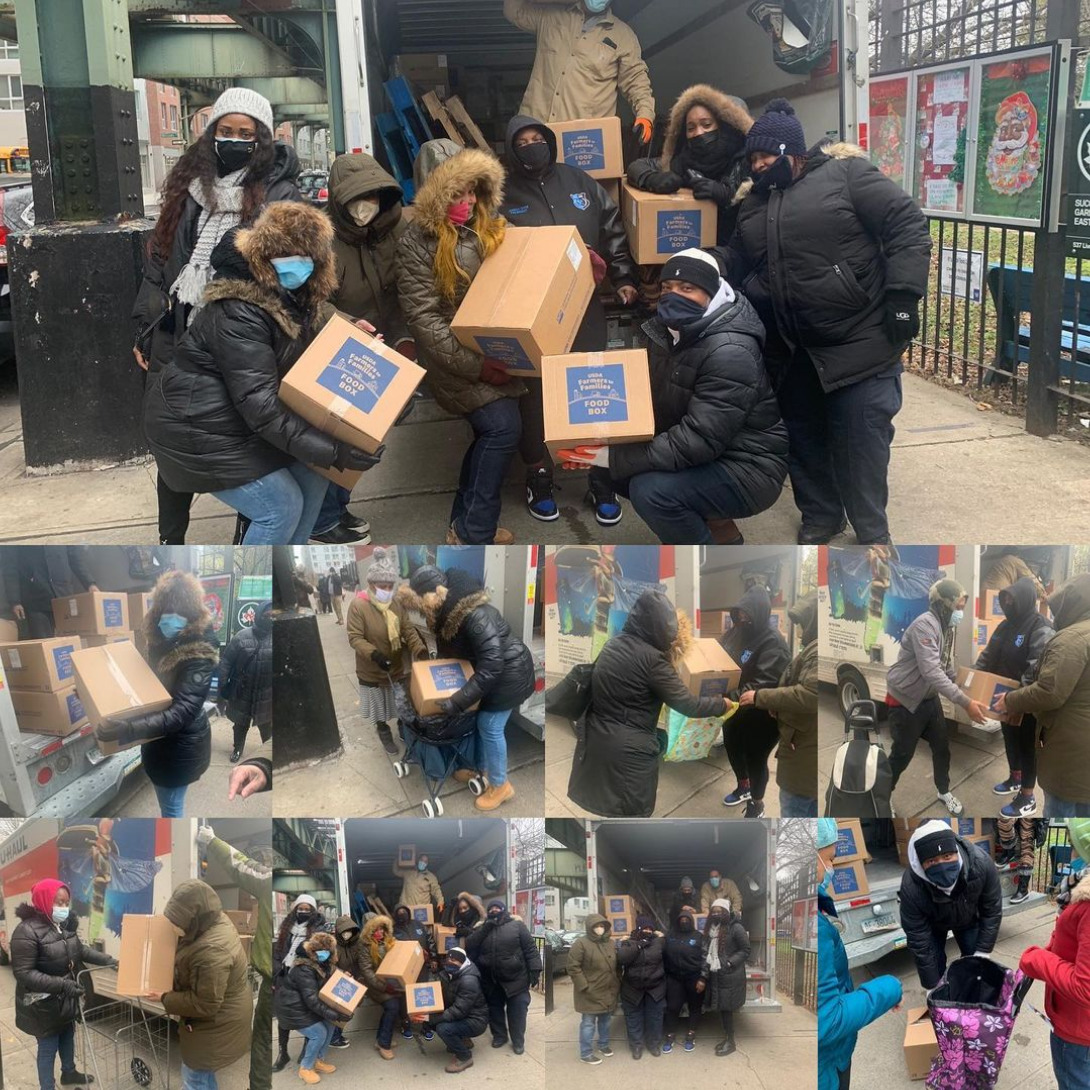 Giving out boxes of food to local residents