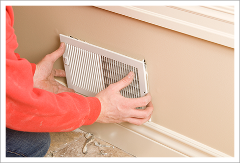Worker installing residential room vent||||