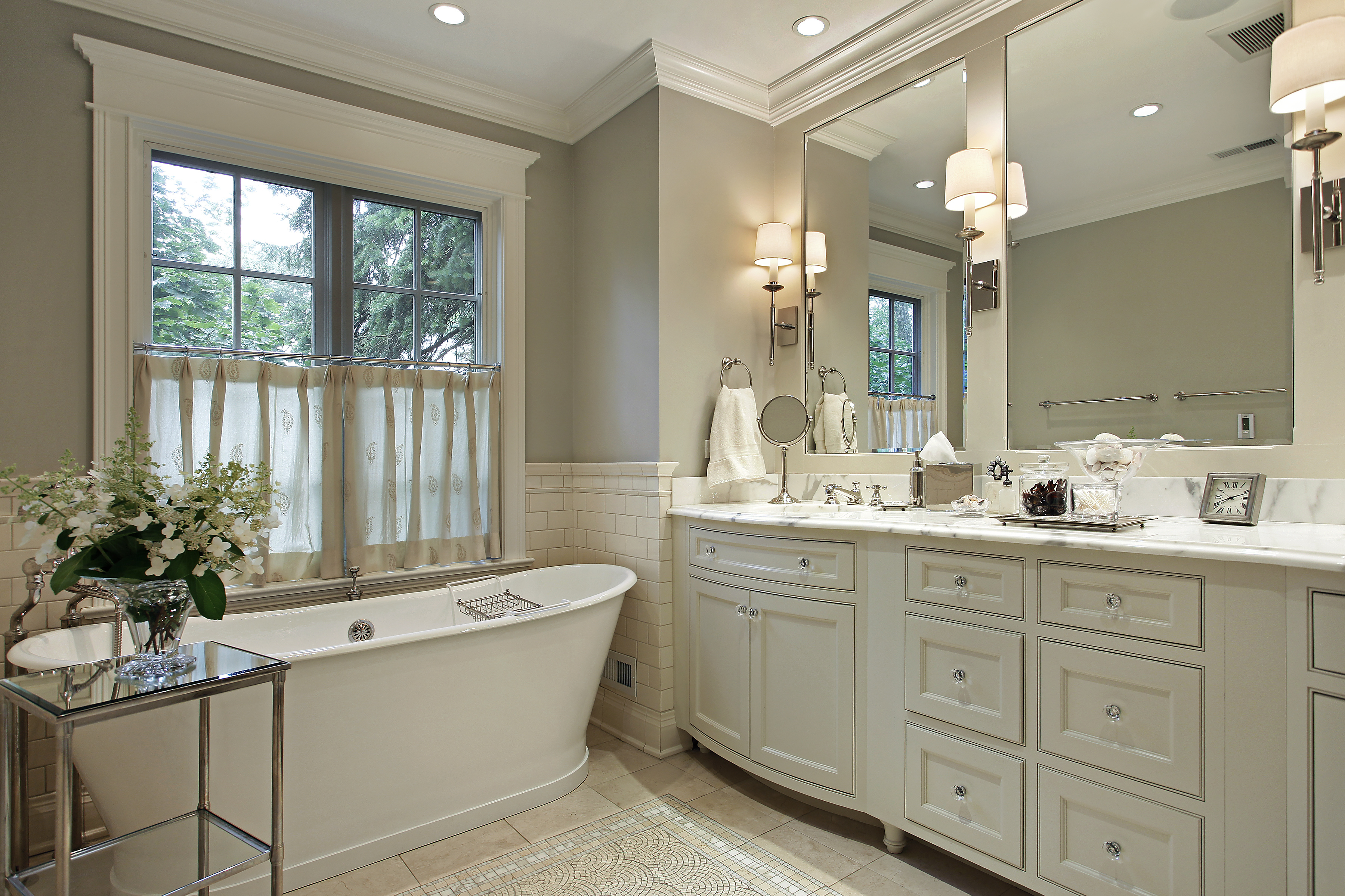 Bathroom Remodel with Marble countertop and elegant trim and wash tub