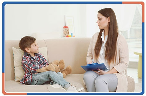 Psychologist Working with Little Boy