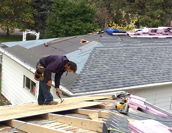 A Professional Roofer Working