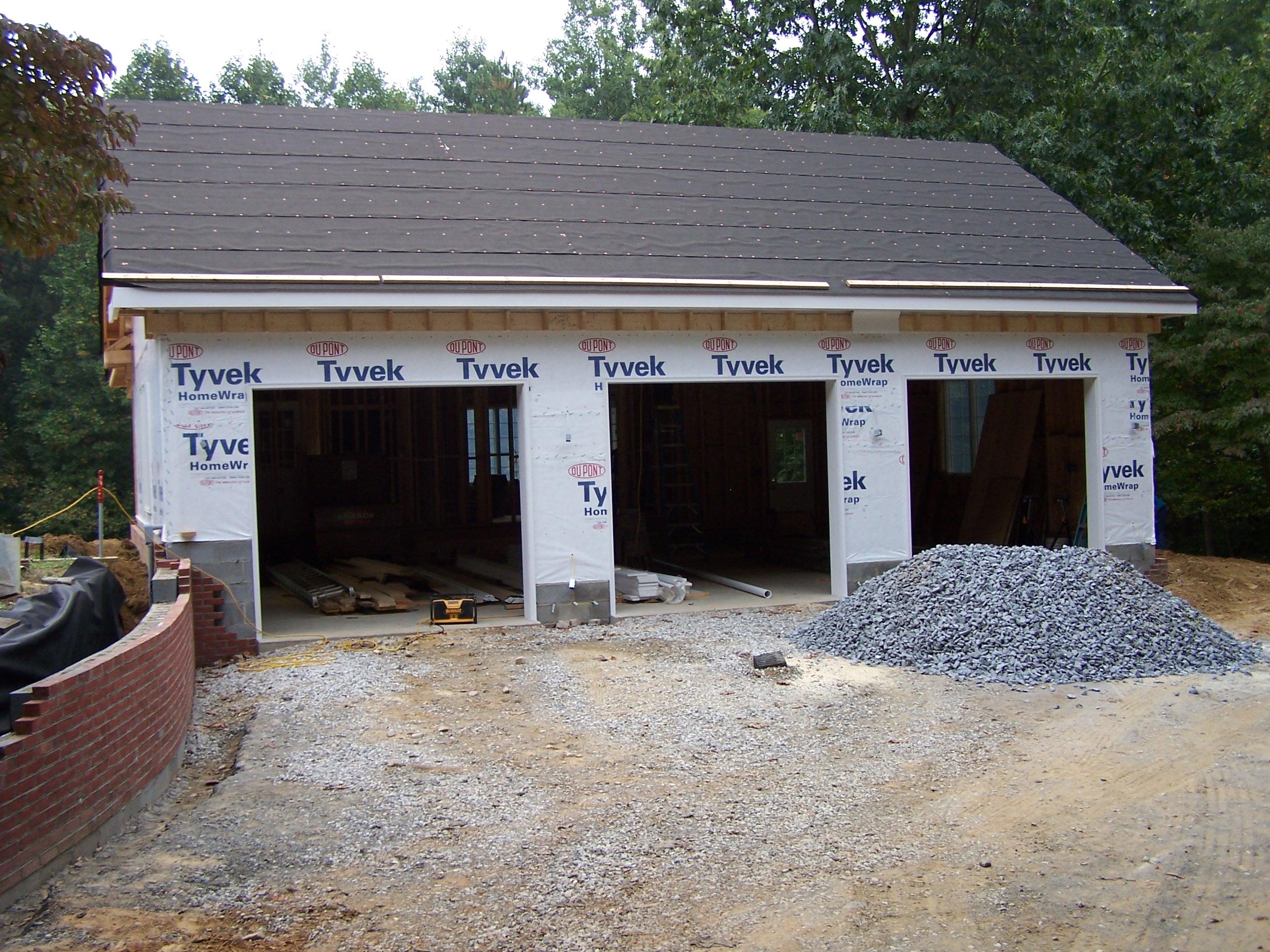 three car garage with pool bath house