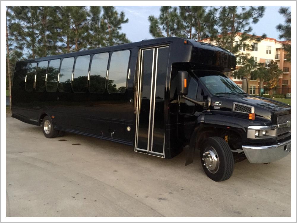 30-32 passenger Black Limousine Bus