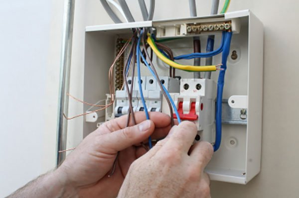 Electrician connecting up a fuse box