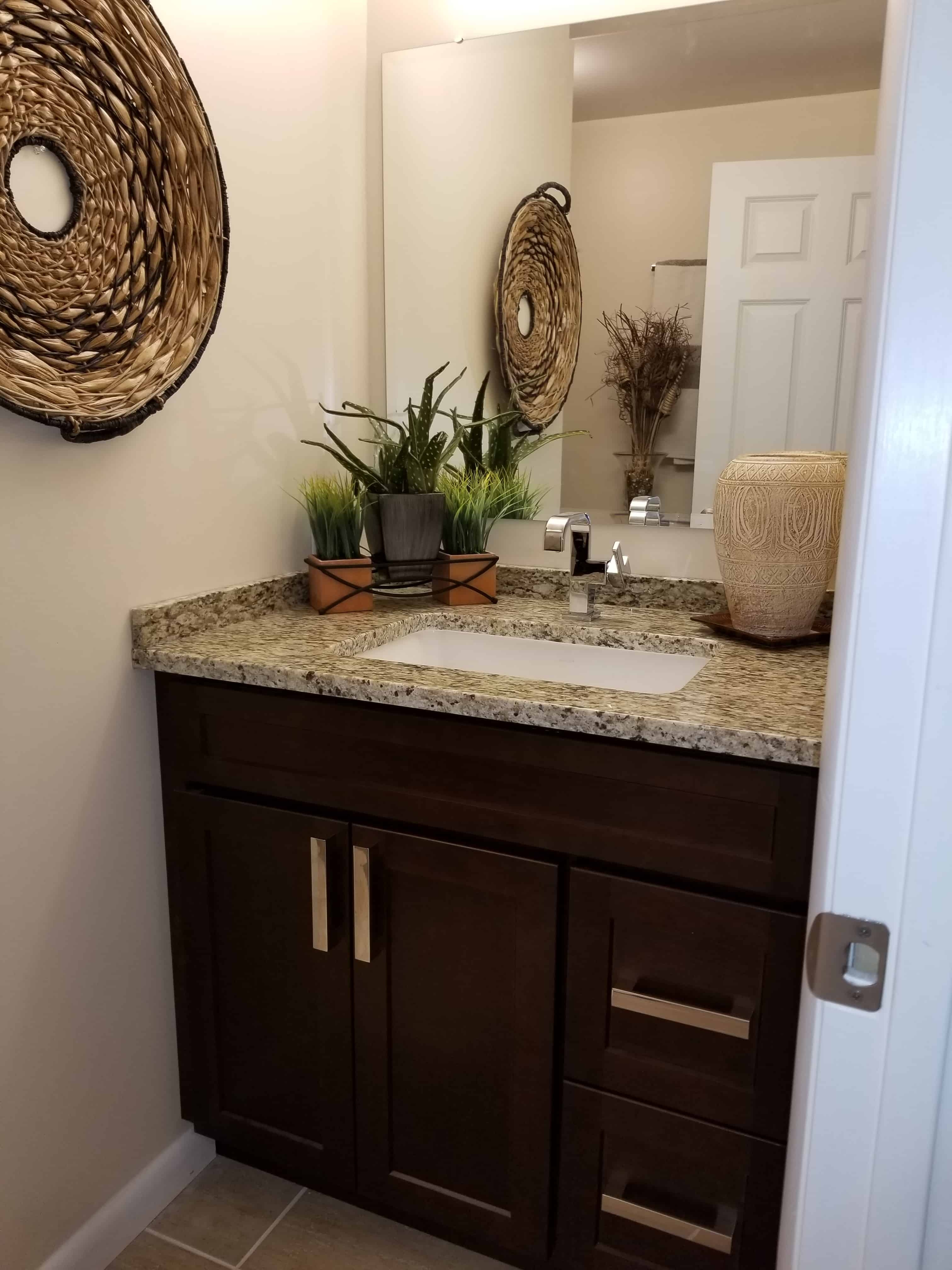 https://0201.nccdn.net/1_2/000/000/15e/2f2/BathroomSinkAndCabinet-min-3024x4032.jpg