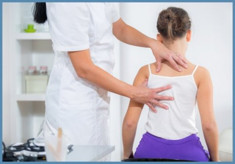 Chiropractor Checking Female Patient
