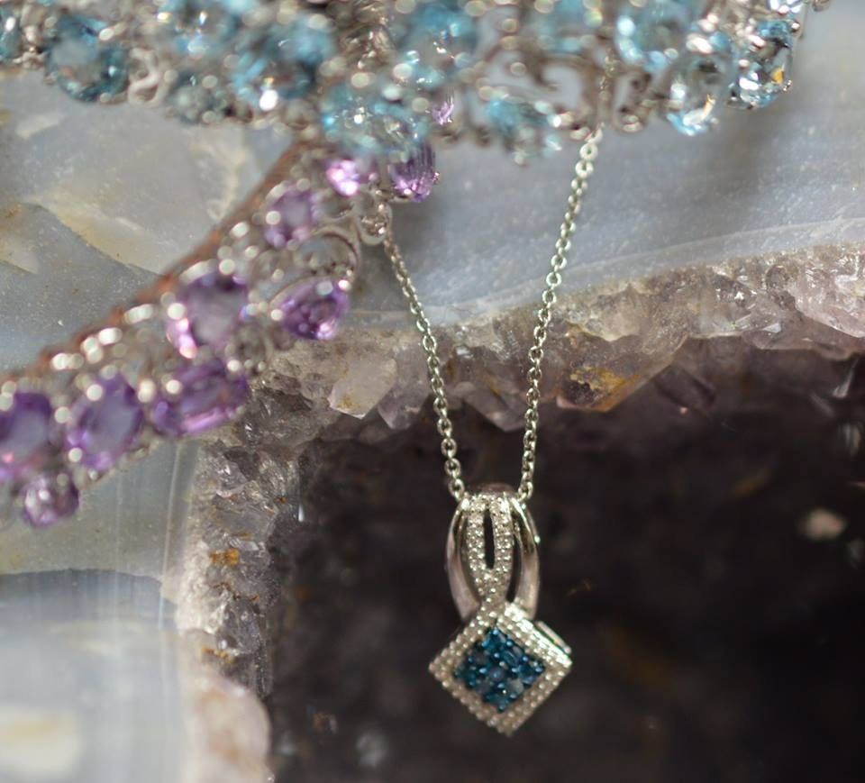 Silver bracelets with blue topaz and amethyst, blue diamond pendant in white gold