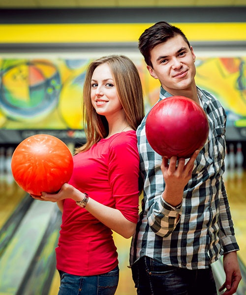 Beautiful Girl and Young Man at The Bowling Alley