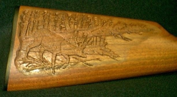 Hand carved deer on walnut stock