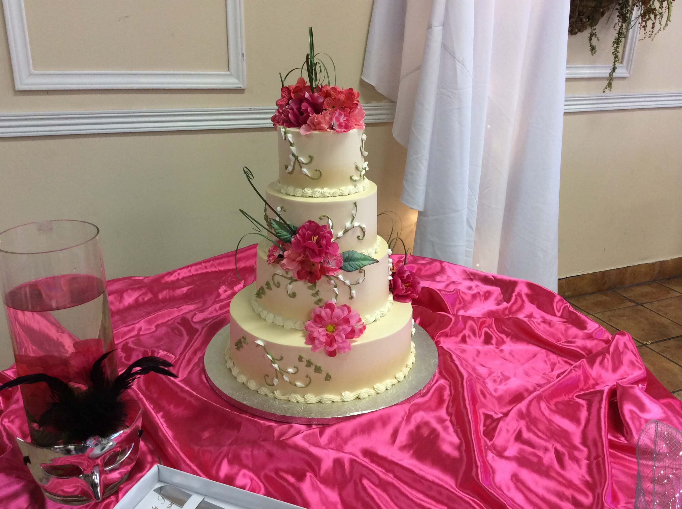 Three-Tier Cake With Pink Flowers