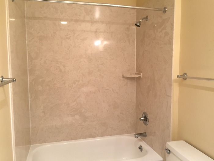 Shower with marble shower walls