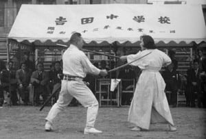 "The writing on the tent states ""Yoshida Middle School, 1958.""  Ms. Kyoko Nakamura died in the 1960s at which time Nakamura sensei stopped performing and teaching these techniques."