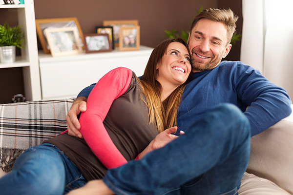 Loving couple relaxing on sofa