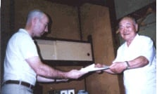 September 1994. Sobetsukai (farewell party). Power sensei receives densho (license of transmission) from Nakamura sensei. Power sensei began his Toyama Ryu Iaido studies in 1983 and later studied directly under Nakamura sensei for four and a half years.