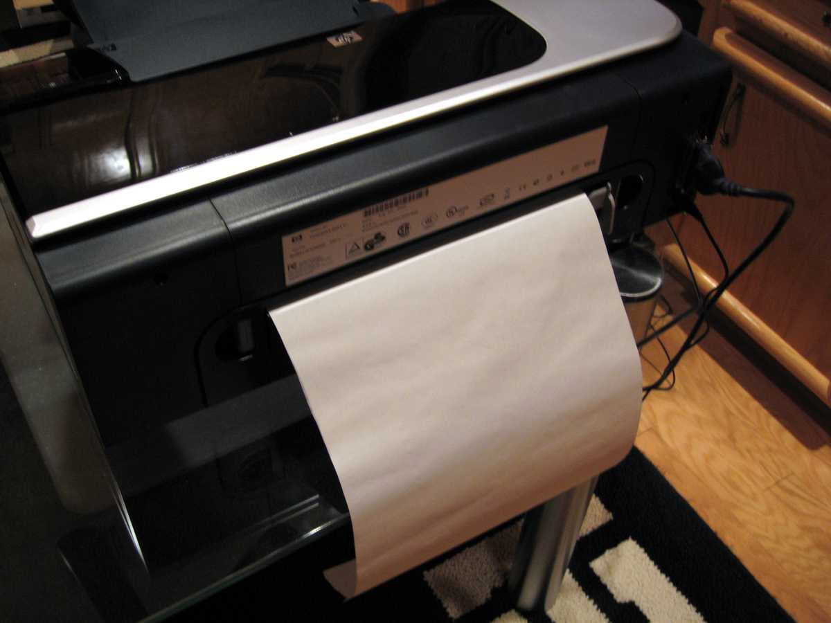 Once the tissue has been applied to the backing sheet, it is ready for printing. Place the tissue/backing sheet in the printer so the tissue will be the printed side. Shown here is an HP Model K850 printer. It supports a straight through paper path, and the tissue/backing sheet has been placed in that feed opening.