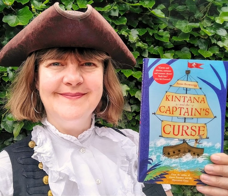 Author Susan Brownrigg with her book Kintana and the Captain's Curse