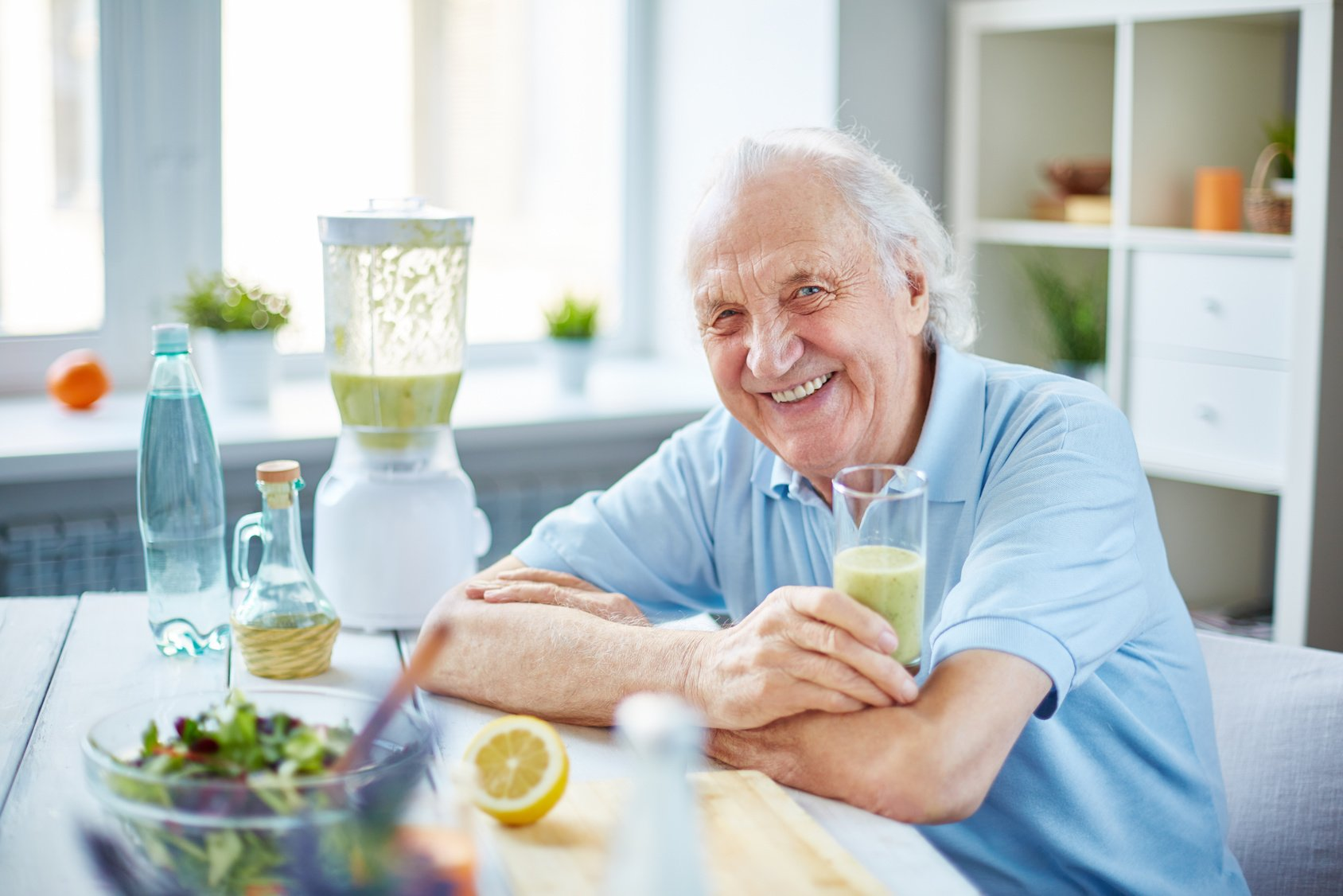 Senior man with glass of smoothie in New Orleans
