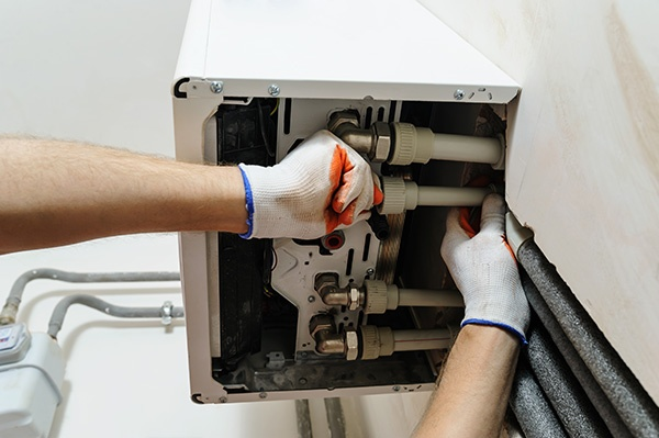 Man installing home heating system