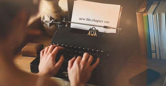 New Life Chapter One Against Young Woman Using Typewriter