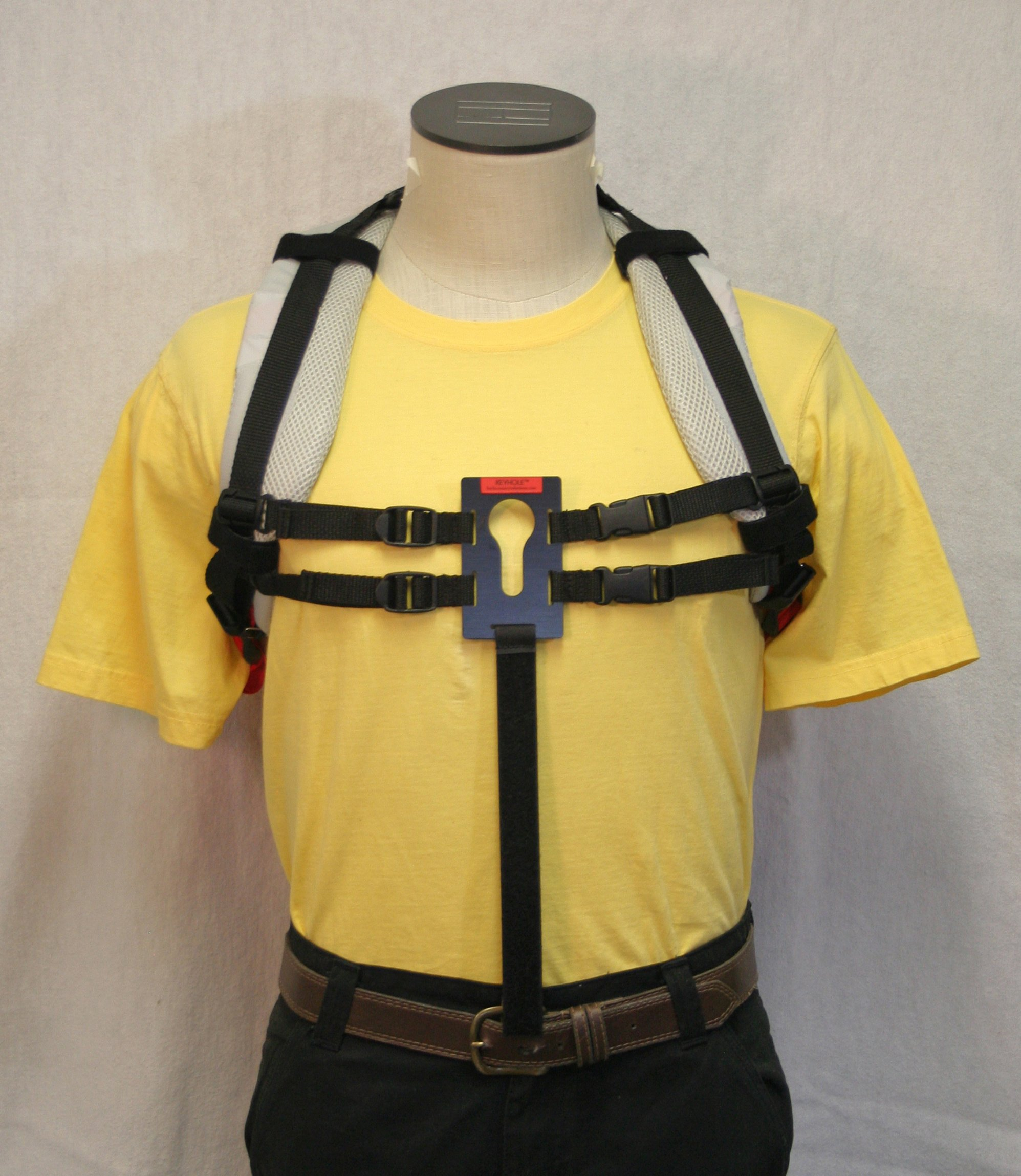 UNIVERSAL KEYHOLE® attached to backpack shoulder straps