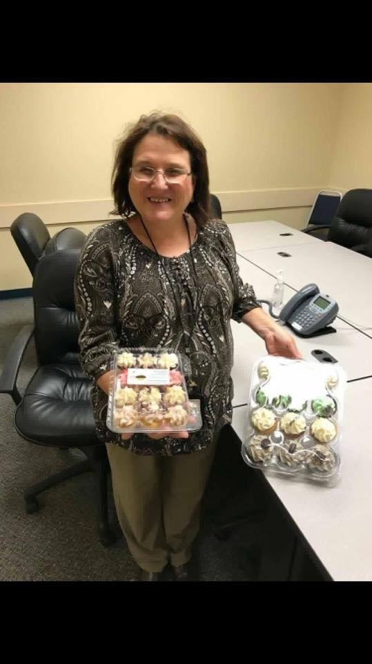 Woman With Two Boxes Of Cupcakes