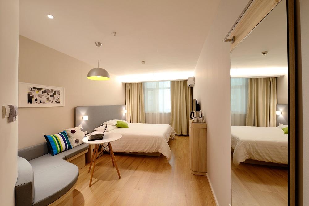 Bedroom with Light Brown Vinyl Plank Flooring