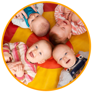 Overhead View Of Babies Having Fun At Playgroup