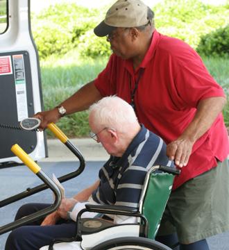 Man helping to elder man