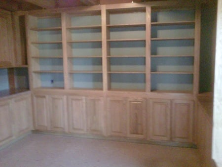 Office cabinets feature raised paneled doors,  arched upper doors, adjustable shelves and desk. Colonial  Maple hand wiped stain with clear coating finishes red oak wood.