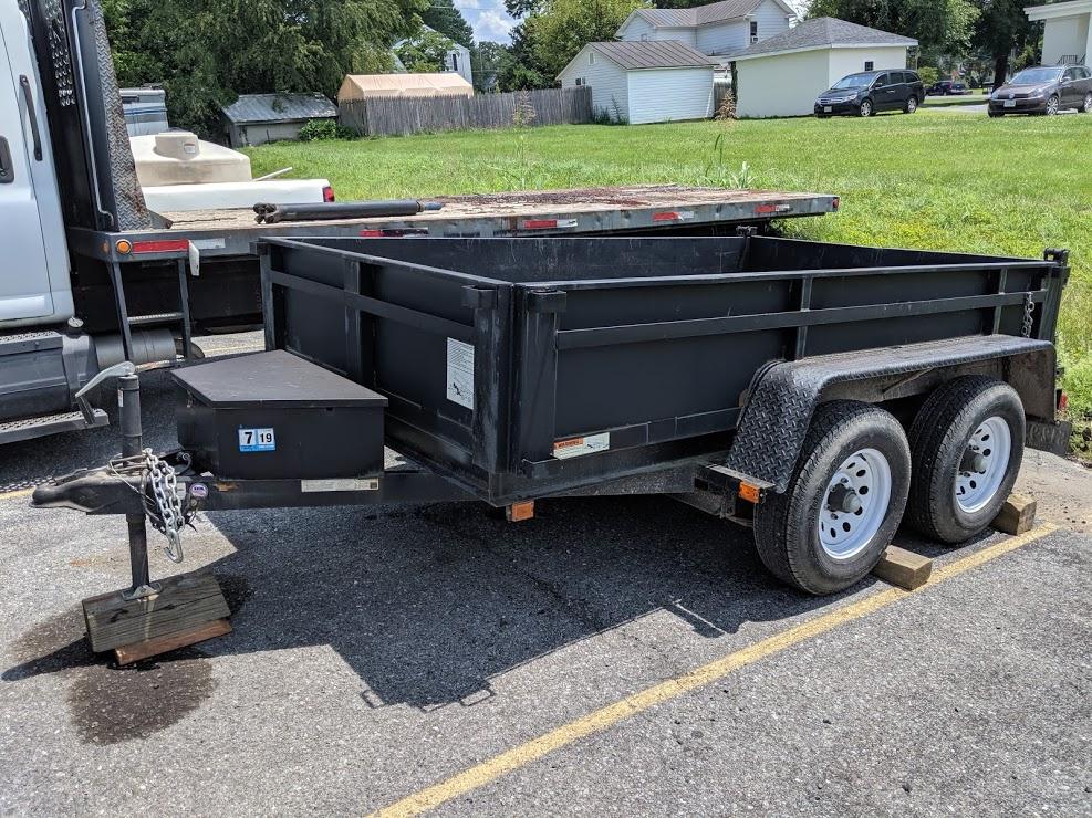 https://0201.nccdn.net/1_2/000/000/174/4a2/dump-trailer-987x740.jpg