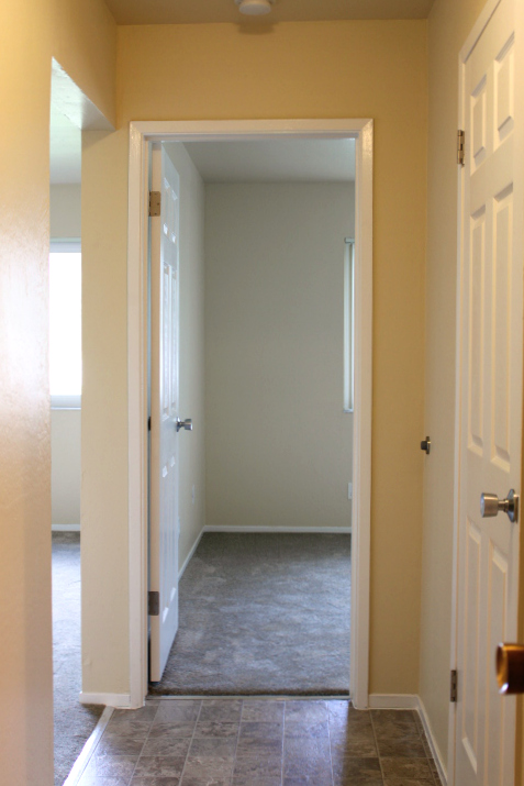 Entry way that leads to the family room and bedroom.