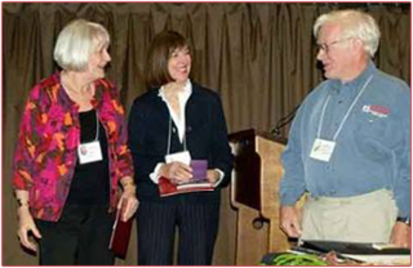Life member Brenda Viney and Darlene Sanders worked for years to bring the World Federation of Rose Societies Convention to Vancouver in June 2009. VRS member and WFRS vice president David Elliot presents them with medals.