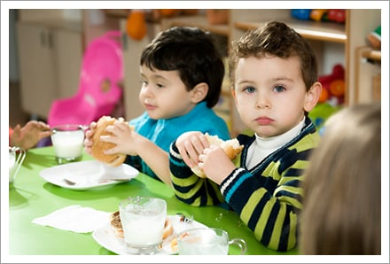 Elementary pupils enjoying healthy lunch
