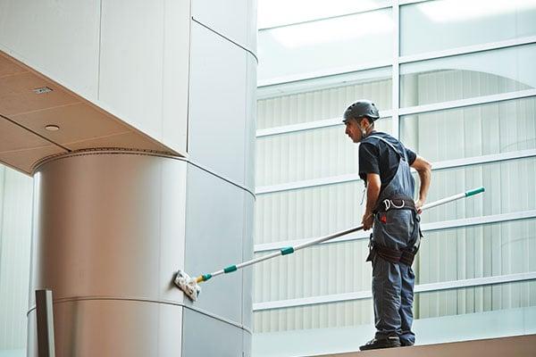 Worker Cleaning Indoor Window