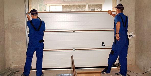 Contractors Installing, Repair, Insulating Garage Door.