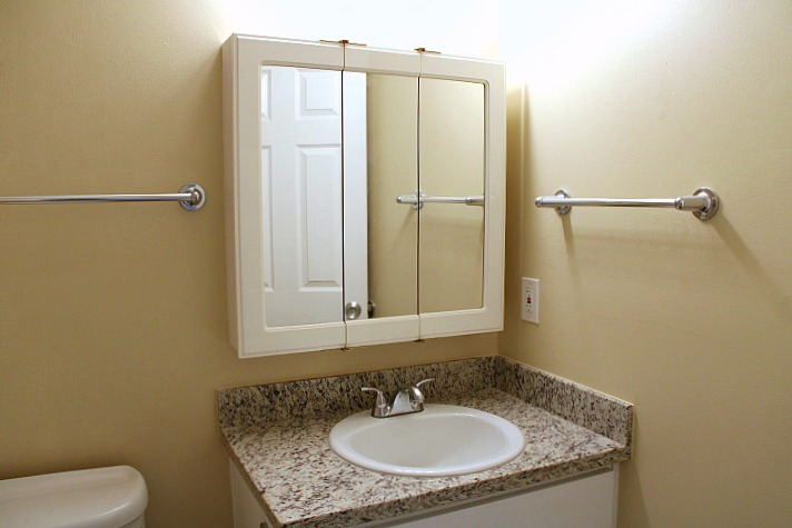 The bathroom also has a new , granite countertop and new cabinets.